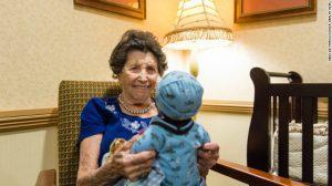 senior holding a baby